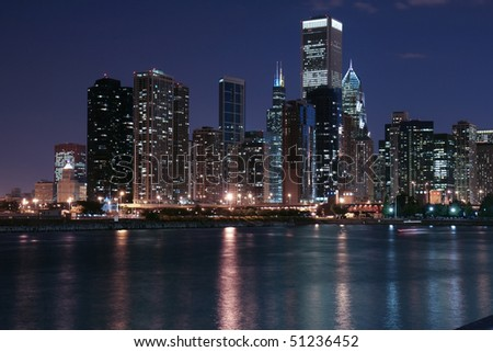 Chicago city skyline and reflection at night - stock photo