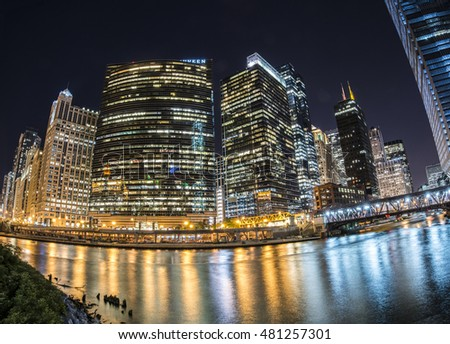 Chicago cityscape at night with reflections on Chicago River