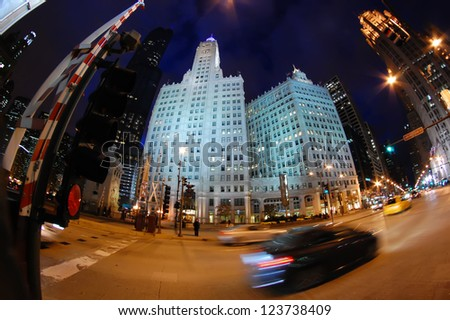 CHICAGO - DECEMBER 2: The Wrigley Building at night on December 2, 2010 in Chicago, Illinois. Ground was broken on Michigan Avenue for the Wrigley Company's chewing gum headquarters in 1920. - stock photo