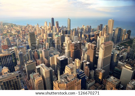 Chicago downtown aerial view at dusk with skyscrapers and city skyline at Michigan lakefront.