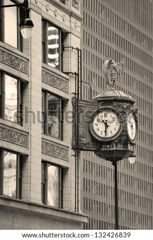 Chicago downtown street view with old fashion clock and skyscraper building in black and white. - stock photo