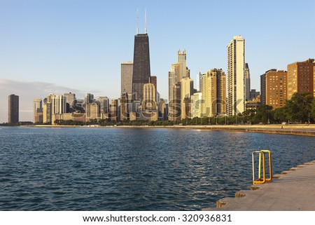 Chicago during summer sunrise. Gold Coast buildings and Lake Michigan. - stock photo