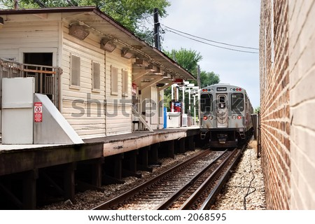 Chicago Elevated Train leaving the station (Kimball Line) - stock photo