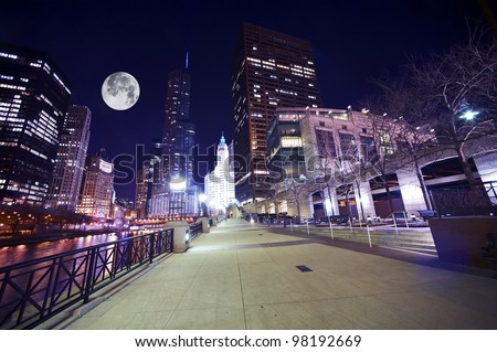 Chicago Famous Riverwalk - Chicago Riverwalk at Night. Beautiful Colorful Wide Angle Photography. Large Moon on the Sky. Chicago, Illinois, USA.
