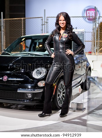 CHICAGO - FEB 9: A model for the Fiat 500 Abarth poses at the 2012 Chicago Auto Show Media Preview on February 9, 2012 in Chicago, Illinois.