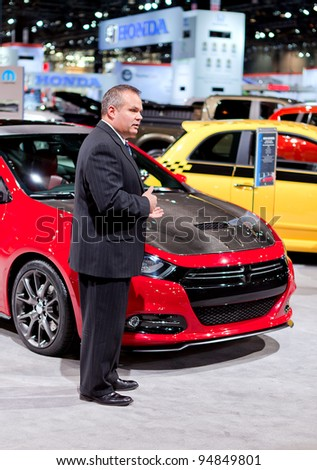 CHICAGO - FEB 9: A Mopar executive talks about the customizations to a Dodge Dart at the 2012 Chicago Auto Show Media Preview on February 9, 2012 in Chicago, Illinois.