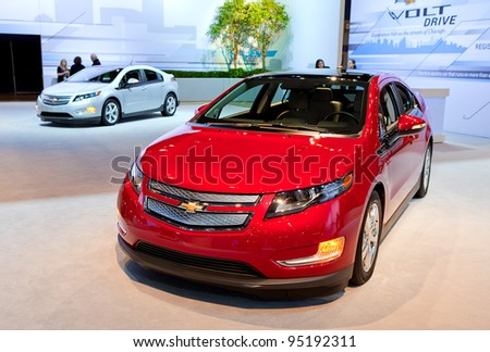CHICAGO - FEB 9: A pair of Chevrolet Volts on display at the 2012 Chicago Auto Show Media Preview on February 9, 2012 in Chicago, Illinois. - stock photo