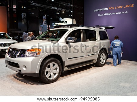 CHICAGO - FEB 8: Employees prep the Nissan Armada for the show opening at the 2012 Chicago Auto Show Media Preview on February 8, 2012 in Chicago, Illinois. - stock photo