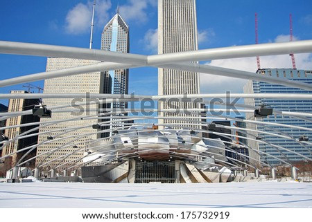 CHICAGO-FEB 09:Jay Pritzker Pavilion with high modern buildings in winter at Millennium Park on February 09, 2008 in Chicago, IL USA. Pavilion hosts concerts and events by capacity for 11,000 people. - stock photo