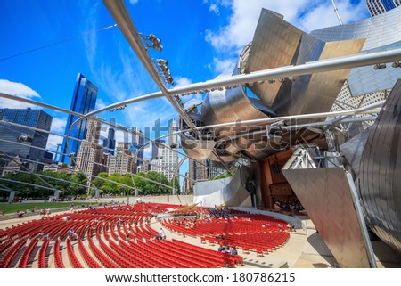 CHICAGO-FEB 09:Jay Pritzker Pavilion with high modern buildings in winter at Millennium Park on February 09, 2014 in Chicago, IL USA. Pavilion hosts concerts and events by capacity for 11,000 people. - stock photo