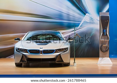 Chicago - February 12: A BMW i8 electric car with charging station on display February 12th, 2015 at the 2015 Chicago Auto Show in Chicago, Illinois. - stock photo