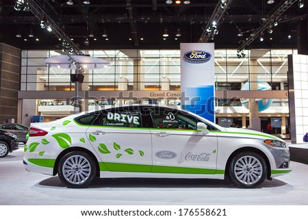 CHICAGO - FEBRUARY 6 : A Ford Fusion on display at the Chicago Auto Show media preview February 6, 2014 in Chicago, Illinois. - stock photo