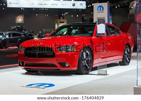 CHICAGO - FEBRUARY 7 : A Mopar modified Dodge Charger on display at the Chicago Auto Show media preview February 7, 2014 in Chicago, Illinois. - stock photo