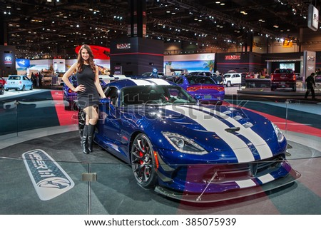 CHICAGO - February 11: An auto show model poses with a Dodge Viper on display at the Chicago Auto Show media preview February 11, 2016 in Chicago, Illinois. - stock photo