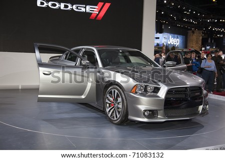 CHICAGO - FEBRUARY 12: Dodge Challenger presentation at the Annual Chicago Auto Show February 12 2011 in Chicago, IL. - stock photo