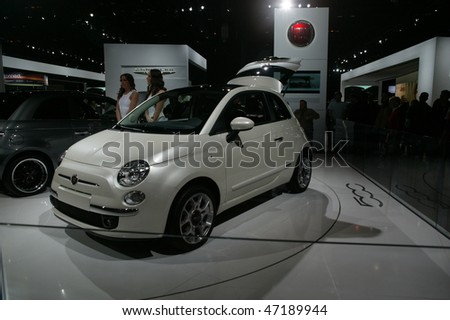 CHICAGO - FEBRUARY 13: Fiat 500 new vehicle presentation at the Annual Chicago Auto Show February 13, 2010 in Chicago, IL. - stock photo
