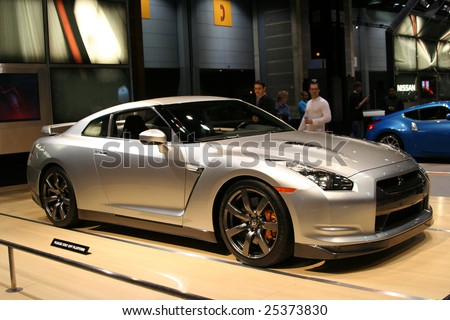 """CHICAGO - FEBRUARY 18 : Nissan launched the new GT-R in the U.S.A. as an """"ultimate super car"""".   displayed at the Auto Show 2009 in Chicago, IL  February 18, 2009. - stock photo"""