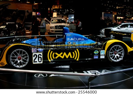 CHICAGO, FEBRUARY 18, 2009: The Acura XM Race car (powered by Acura) took first in the LMP2 class at the historic Twelve Hours of Sebring race. Displayed at the Auto Show 2009 in Chicago. - stock photo