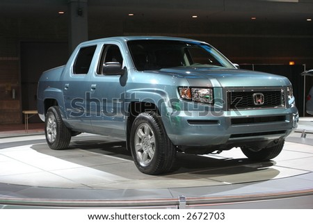 """CHICAGO - FEBRUARY 10 :""""The Honda Ridgeline places a high priority on refinement, packaging and the everyday needs of pickup truck users, displayed at Chicago Auto Show on February 10, 2007 - stock photo"""
