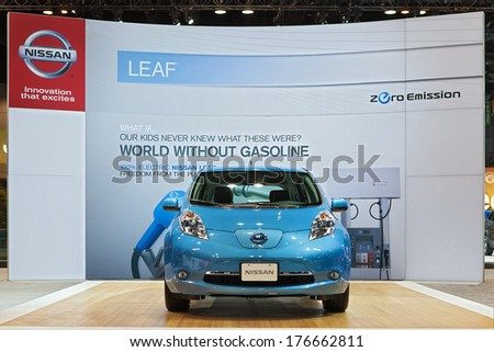 CHICAGO - FEBRUARY 7 : The Nissan Leaf electric vehicle on display at the Chicago Auto Show media preview February 7, 2013 in Chicago, Illinois. - stock photo