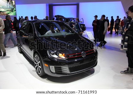CHICAGO - FEBRUARY 12: The Volkswagen Golf GTI presentation at the Annual Chicago Auto Show on February 12, 2011 in Chicago, IL. - stock photo