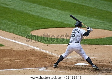 CHICAGO, IL - APRIL 29: Brent Lillibridge hits for the Chicago White Sox vs. Seattle Mariners at U.S. Cellular Field April 29, 2009 in Chicago, IL. - stock photo