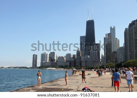 CHICAGO, IL - AUGUST 14: People watch the annual Chicago Air and Water show on August 14, 2010 in Chicago, IL
