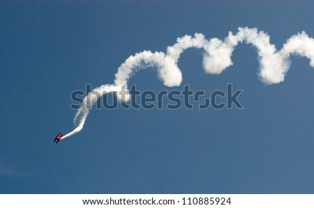 CHICAGO, IL - AUGUST 18: Skilled stuntman maneuver an unidentified plan in corkscrew fashion during airshow on Chicago Lakefront August 18, 2012 in Chicago, IL.