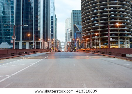 """CHICAGO, IL - CIRCA APRIL, 2016: streets of Chicago at evening. Chicago, colloquially known as the """"Windy City"""", is the third most populous city in the USA, following New York and Los Angeles - stock photo"""