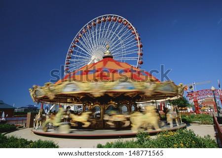 CHICAGO, IL - CIRCA 1999: Carousel at amusement park in Chicage, IL.  - stock photo