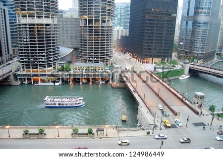 CHICAGO, IL - JUNE 25: Marina City is a complex of two 60-story towers built in 1964 on June 07, 2011 in Chicago, USA. Apartments, offices, restaurants, banks, theater,18 stories of parking space. - stock photo