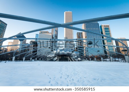 CHICAGO, IL - March 6, 2015: The Jay Pritzker Pavilion and Great Lawn in winter, Chicago, Illinois, USA. The Pavilion, designed by Frank Gehry, is an outdoor performing arts venue. - stock photo