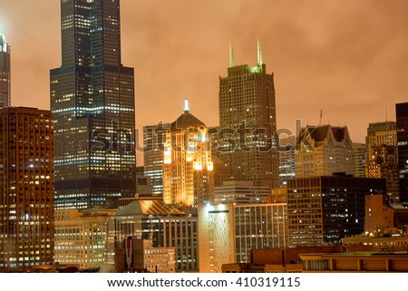 CHICAGO, IL - MARCH 27, 2016: view of Chicago at night. The city is an international hub for finance, commerce, industry, technology, telecommunications, and transportation.