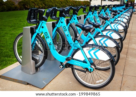 CHICAGO, IL - MAY 4, 2014: Available bikes for rent at the Divvy station on Northerly Island Chicago. Divvy is one of the largest bike sharing systems in the United States.  - stock photo
