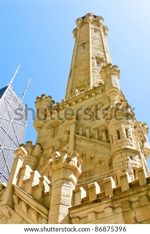 CHICAGO,IL - MAY 15: Chicago Water Tower on May 15, 2009 in Chicago. Built in 1869 on Michigan Avenue and is one of the few structures to survive the Great Chicago Fire of 1871. - stock photo