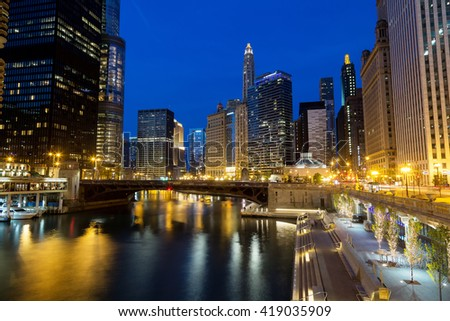 CHICAGO, IL -7 MAY: Downtown Chicago, the Chicago River, and the Riverwalk at dusk.