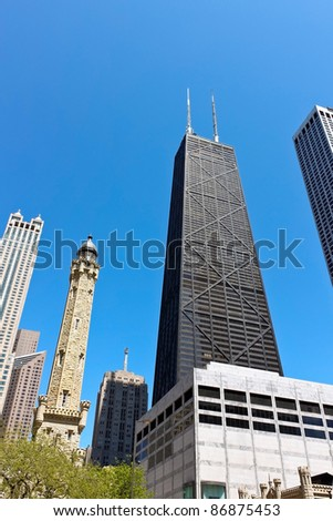 CHICAGO,IL-MAY 15:The John Hancock building on Michigan Ave(Magnificent Mile) on May 15, 2009 in Chicago. In 1968 it was the tallest building outside of New York. It stands next to Water Tower Place. - stock photo