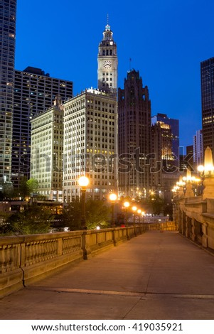 CHICAGO, IL - 7 MAY: The Wrigley Building and the Chicago riverwalk at dusk.