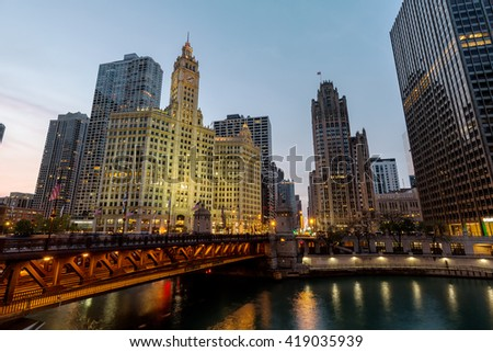 """CHICAGO, IL - 6 May: The Wrigley Building and the Tribune Tower flank the north end of the Michigan Ave bridge. This marks the beginning of Chicago's """"Magnificent Mile"""".  - stock photo"""