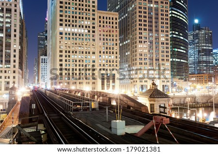 CHICAGO, IL - OCT 5, 2011: Metro  ways in Chicago downtown at night on October 5, 2011 in Chicago, Illinois. Chicago is the third most populous city in the United States, after New York City and Los Angeles - stock photo