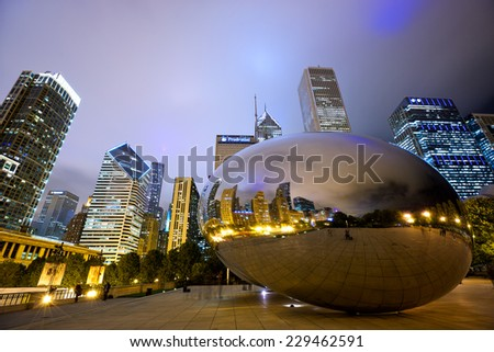 CHICAGO, IL - SEP 15: Cloud Gate sculpture and downtown skyline on September 15, 2014 in Chicago, Illinois. The famous landmark of Chicago in Millennium Park at night. - stock photo