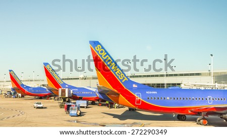 CHICAGO,IL/USA - April 11, 2015: Three Southwest airplanes parked at a Chicago Midway (MDW) International Airport terminal.
