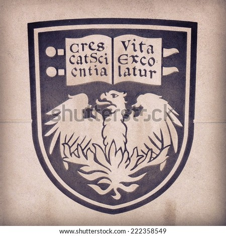 CHICAGO, IL, USA - OCTOBER 8, 2014: Stone relief of the official crest of the University of Chicago on a campus building in the Hyde Park area of Chicago, IL, USA on October 8 2014. - stock photo