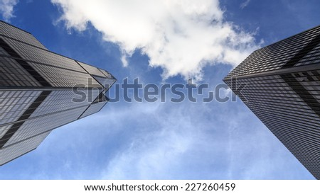 CHICAGO, IL, USA - OCTOBER 11, 2014: View at the sky between Willis Tower and a neighboring skyscraper in Chicago, IL, USA on October 11, 2014. - stock photo