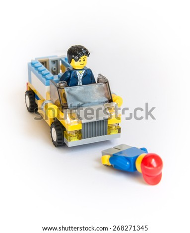 Chicago, Illinois April 8, 2015 : Clean and Nice Image  of group of Lego mini figure driving a car and accident - stock photo