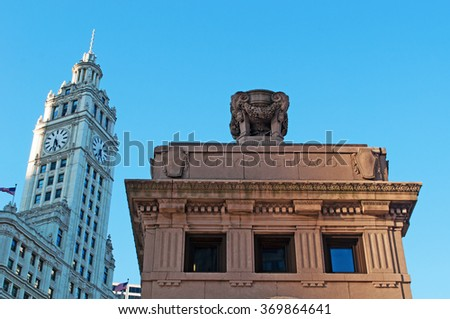 Chicago, Illinois: city inscription on Michigan Avenue Bridge and Wrigley building on September 22, 2014. Wrigley building was built to house the corporate headquarters of Wrigley Company - stock photo