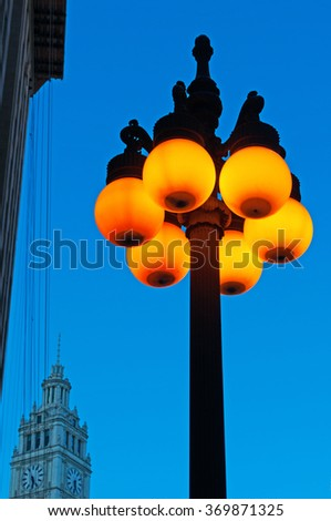 Chicago, Illinois: details of a street lamp lit and Wrigley building on September 22, 2014. Wrigley building was built to house the corporate headquarters of Wrigley Company - stock photo