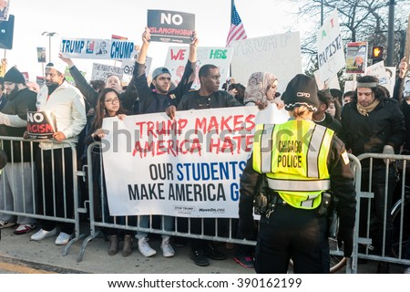 Chicago, ILLINOIS - MARCH 11, 2016: Protesters demonstrate against hate-speech outside the Donald Trump rally at the University of Illinois at Chicago Pavilion. - stock photo