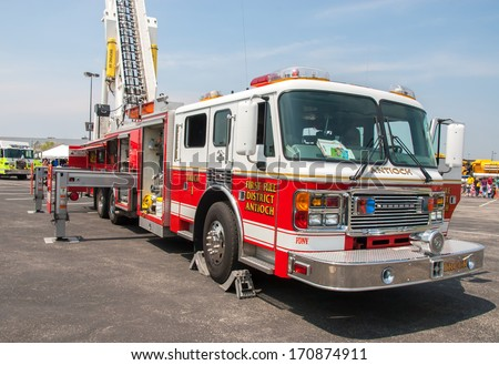 Chicago, ILLINOIS - MAY 18, 2013: A Fire Truck with Ladder on display in Chicago Suberb as part of Fire awareness exercise on May 18, 2013. - stock photo
