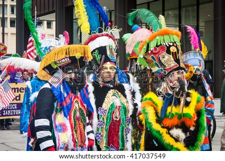 CHICAGO, ILLINOIS - MAY 1, 2016: Cinco De Mayo parade participants at the May Day March calling for immigration reform and worker's rights. - stock photo
